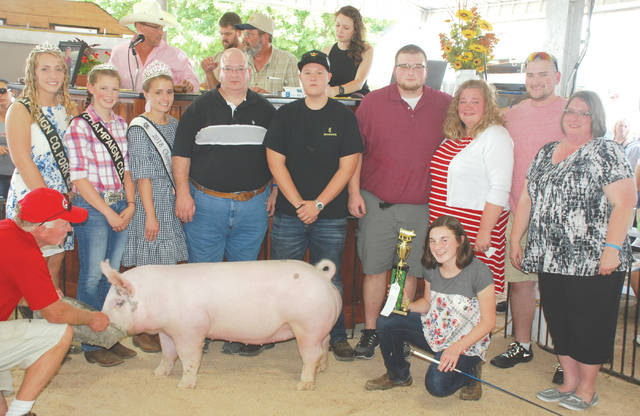 Sara Hess's Reserve Champion Scramble Hog was sold to a syndicate for nearly $10,000 to help fund a memorial scholarship.