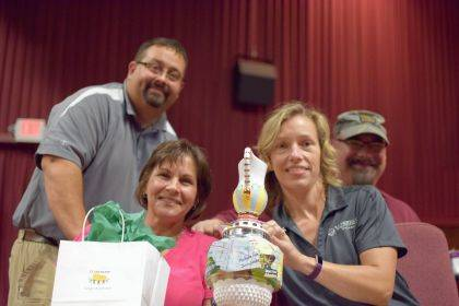 """Leadership participants from the 2017 class smile with the program's """"traveling trophy"""" after winning an activity last year. Pictured are Don Burley, Jenny White, Mechele Frost and Bryan Boyer."""