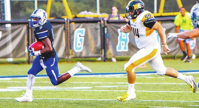 Urbana University's Khaliq Muhammad (left) heads to the end zone during a win over West Liberty University on Aug. 30 at UU. The Blue Knights (1-0) play at Fairmont State (1-0) on Saturday.